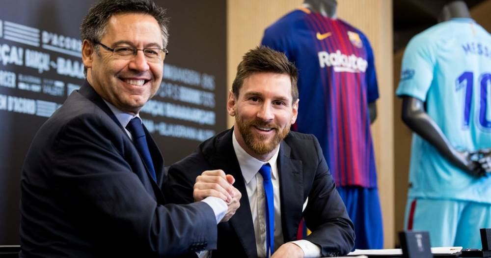 Barcelona president Josep Maria Bartomeu seen here with Lionel Messi